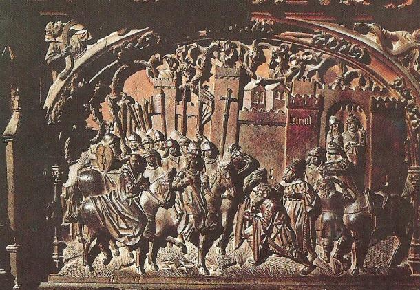 """La Toma de Setenil el 21 de septiembre de 1484 quedó reflejada en uno de los respaldos de la soberbia Sillería de la Catedral de Toledo. El Coro bajo, donde está Setenil, está formado por cincuenta asientos en cuyos respaldos se relata el hito de la conquista cristiana del Reino de Granada. Está labrada por el maestro Rodrigo Alemán entre 1489 y 1495. La escena muestra la rendición del alcaide """"moro"""", El Cordi, ante el Rey Fernando el Católico. Isabel estaba en Córdoba. Unos 200 vecinos musulmanes serán escoltados hasta Ronda. Un reducido grupo, unos 25, se quedará y fundará Alcalá del Valle. Abajo podéis ver un mapa con su localización."""