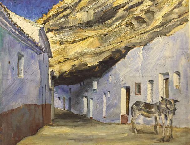 """""""Cuevas de la sombra. Setenil de las Bodegas"""". Óleo (54x65 cm) pintado por Amalio García del Moral hacia 1970, dentro de su colección de """"Paisajes con alma"""", en la que aparece junto a cuadros de Guadix, el puente de Triana o La Alhambra. Los burros que se ven en la imagen son los que utilizaba Gonzalo el del Pan para el reparto. Amalio no concebía el paisaje sin la presencia humana. Imagen cedida por la Fundación Amalio. La foto del cuadro es de ÁNGEL MEDINA. Más información aquí http://goo.gl/hHznGi"""