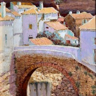 El histórico puente de Triana, con la peña de la fortaleza y la calle Mina al fondo, y el Guadalporcún girando hacia las Cabrerizas. Foto. ÁNGEL MEDINA LAÍN.