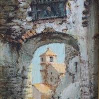 El antiguo Arco de la Villa, en una imagen que refleja su anterior fisonomía, antes de su reforma y de la construcción del colegio que cerró el perímetro del Torreón.